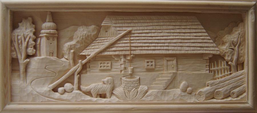 Drevorezba drevenej dediny s kostolom umenie z dreva