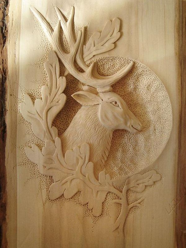 drevorezba jelenej hlavy, poľovnícke obrazy